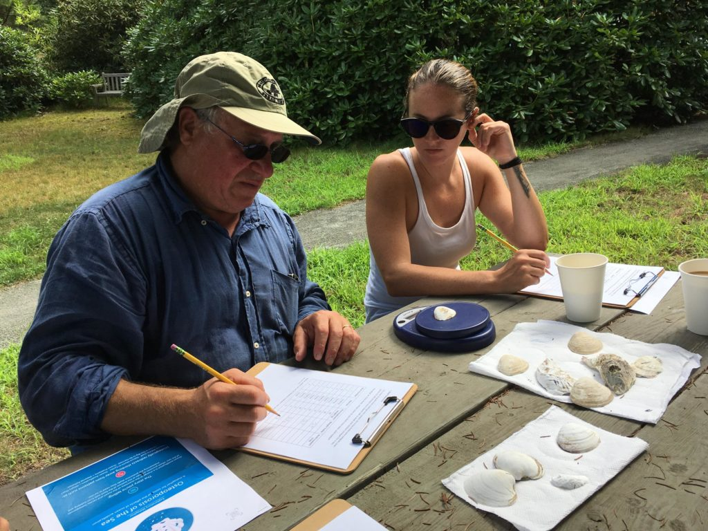 Jonah Maidoff and Casey Hayward, both teachers on the Vineyard, at a workshop on climate change and ocean acidification. (Photo by Samantha Fields/GroundTruth)