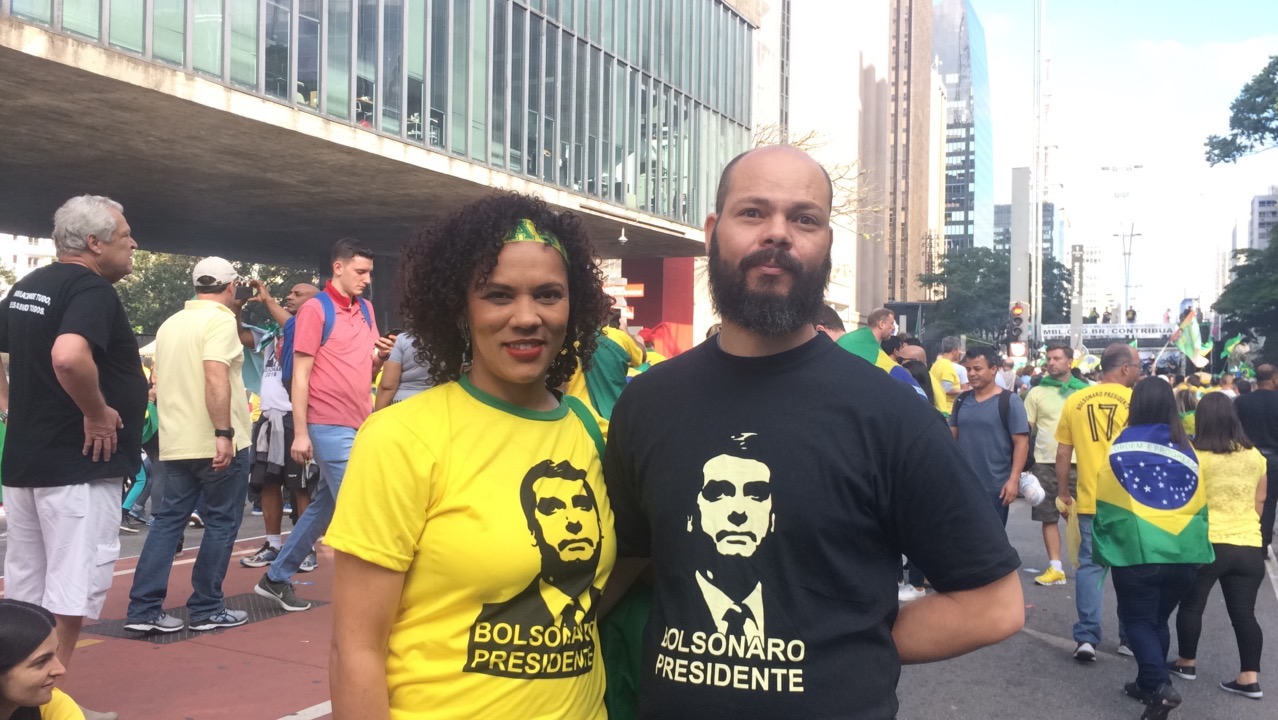 """Small business owner Ligia Paula attended a pro-Bolsonaro demonstration on October 21, one week before the runoff. She believes the Bolsonaro's remarks are often """"jokes"""" taken out of context by the media. """"They only show Jair, in a moment of fury, saying what he shouldn't have"""". (Photo by Giulia Afiune/GroundTruth)"""