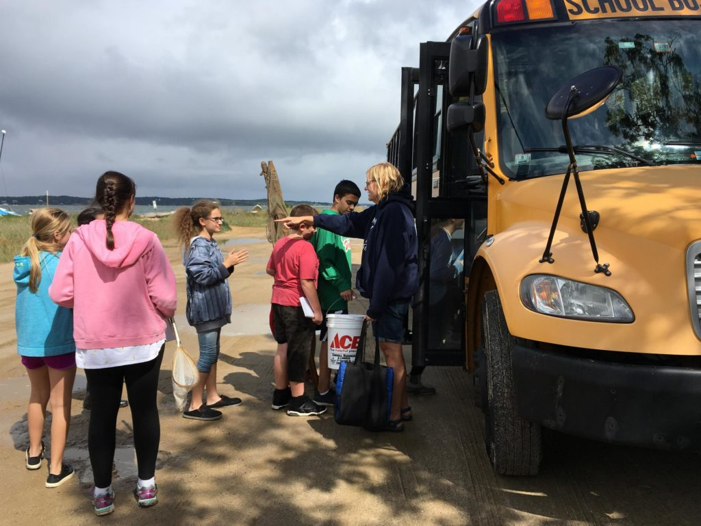 Seventh graders from Monomoy Regional Middle School board the bus after a field trip at Muddy Creek.  (Photo by Samantha Fields/GroundTruth)