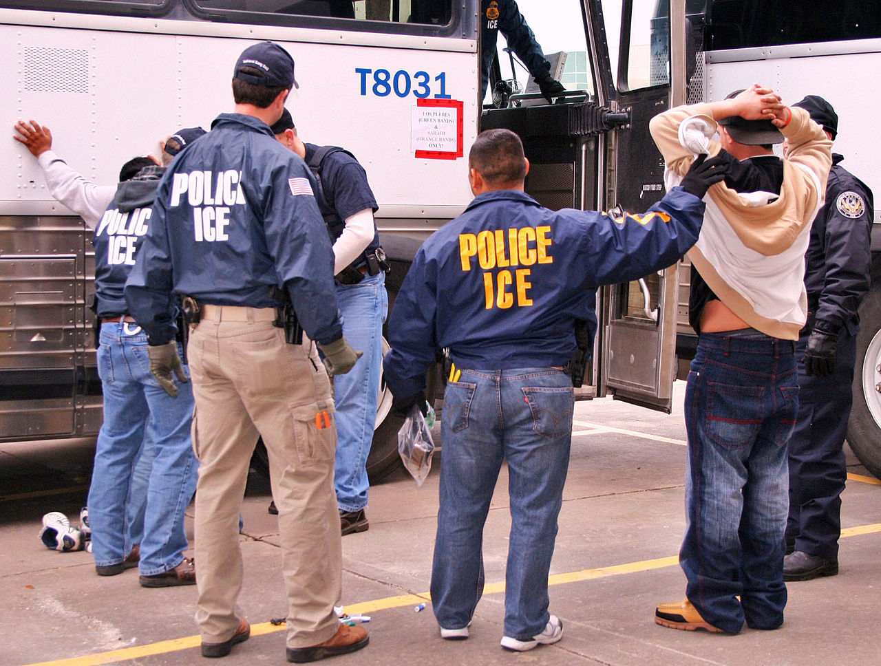 ICE agents detain a man in Houston. (Photo by ICE)
