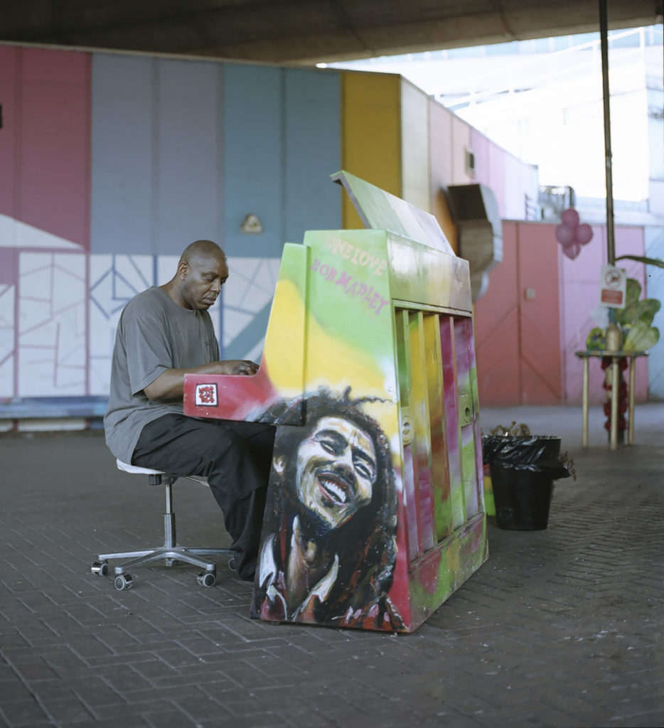 A local resident played on the public paino located outside The Wall of Truth, beneath the Westway.
