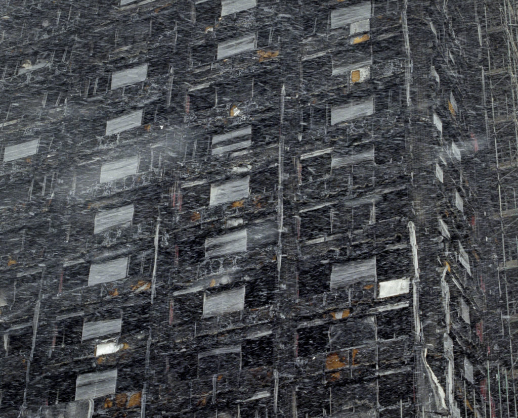 A fluke snow storm in March, swarmed around the skeletal remains of Grenfell Tower in London's North Kensington. (March, 2018)