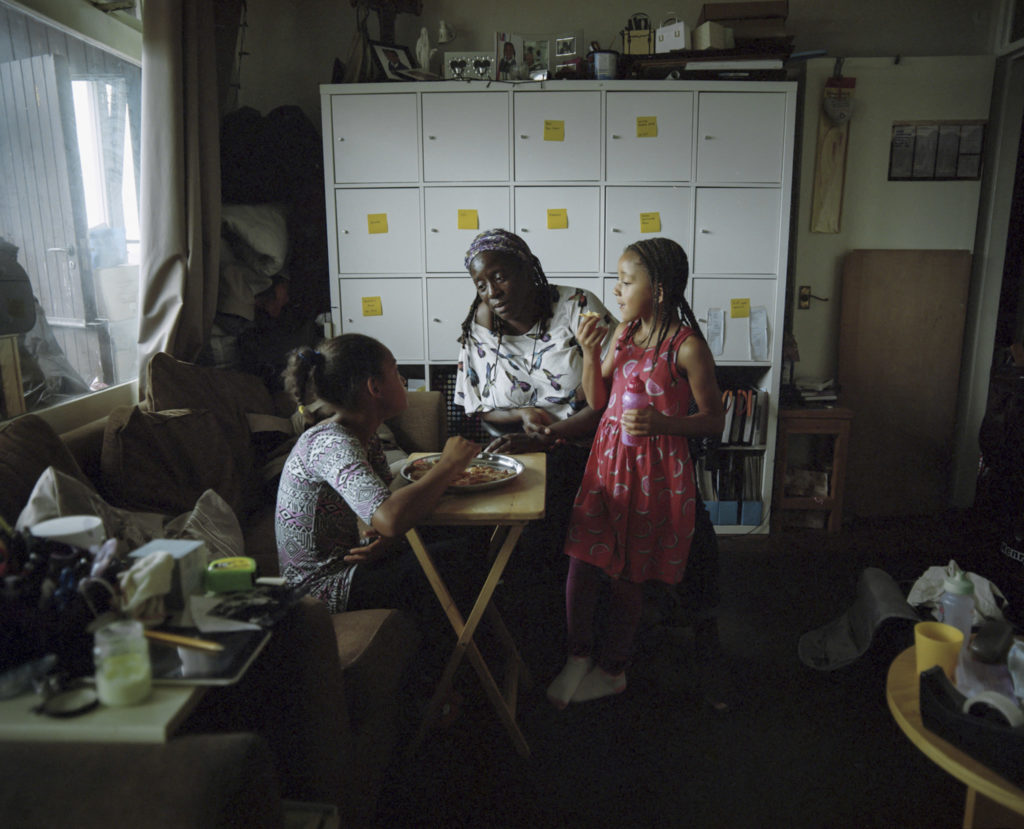 Noreen King sits with her two Grandchildren Franki (left) and Maicee (right) in Trellick Tower of North Kensington.