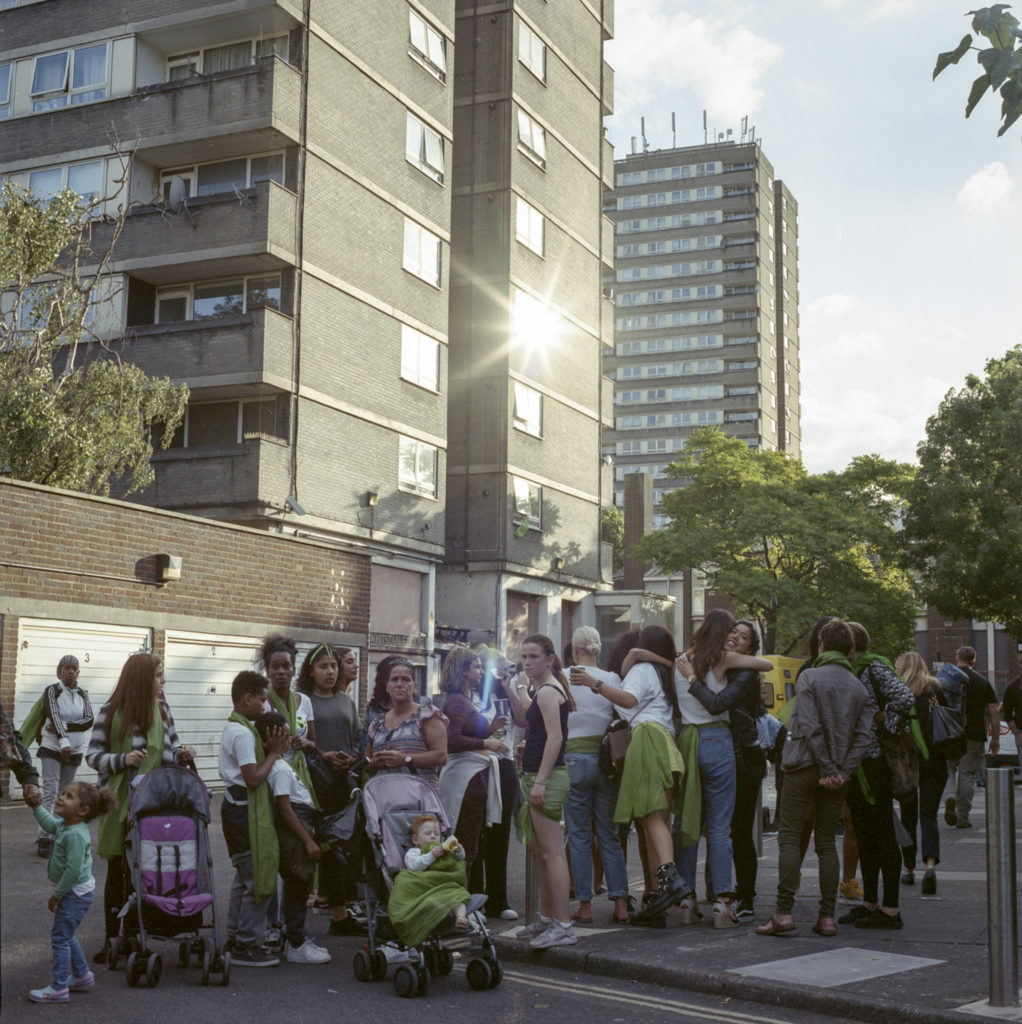 Neighboring residents from the surrounding tower blocks and estates, gathered for the Grenfell Memorial March on the one year anniversary of the Grenfell Tower fire. (June 14th, 2018)