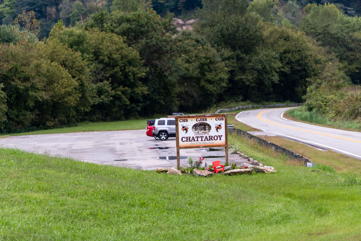 A sign greets visitors to Chattaroy, Oct. 2, 2018, in Mingo County, W.Va. CREDIT JESSE WRIGHT / WEST VIRGINIA PUBLIC BROADCASTING
