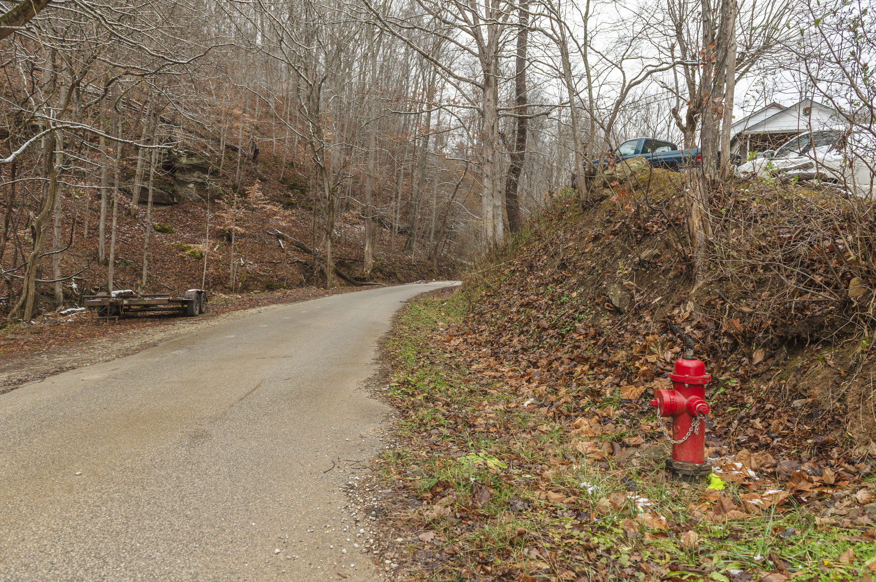 A fire hydrant off of Harless Fork Road in Branchland, Lincoln County, marks the end of Branchland-Midkiff Public Service District's water lines. Allen Adkins, who lives one tenth of a mile up from the hydrant, has been petitioning since 2013 to get water lines extended to his home.  (Photo by Craig Hudson | Gazette-Mail)