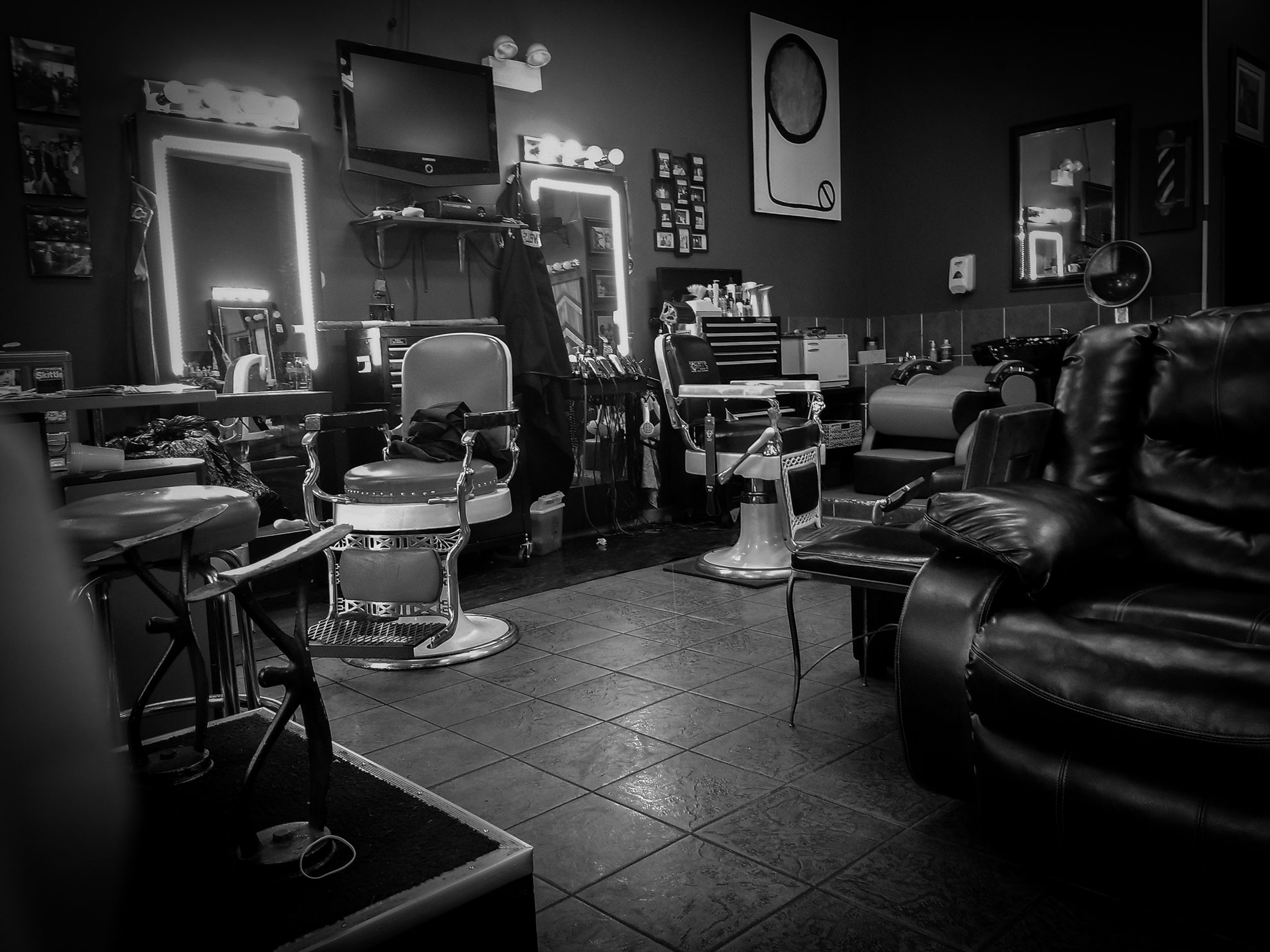 A couple of chairs left unattended at a barber shop in Englewood, a neighborhood on Chicago's South Side.  (Photo  by Manny Ramos/GroundTruth)