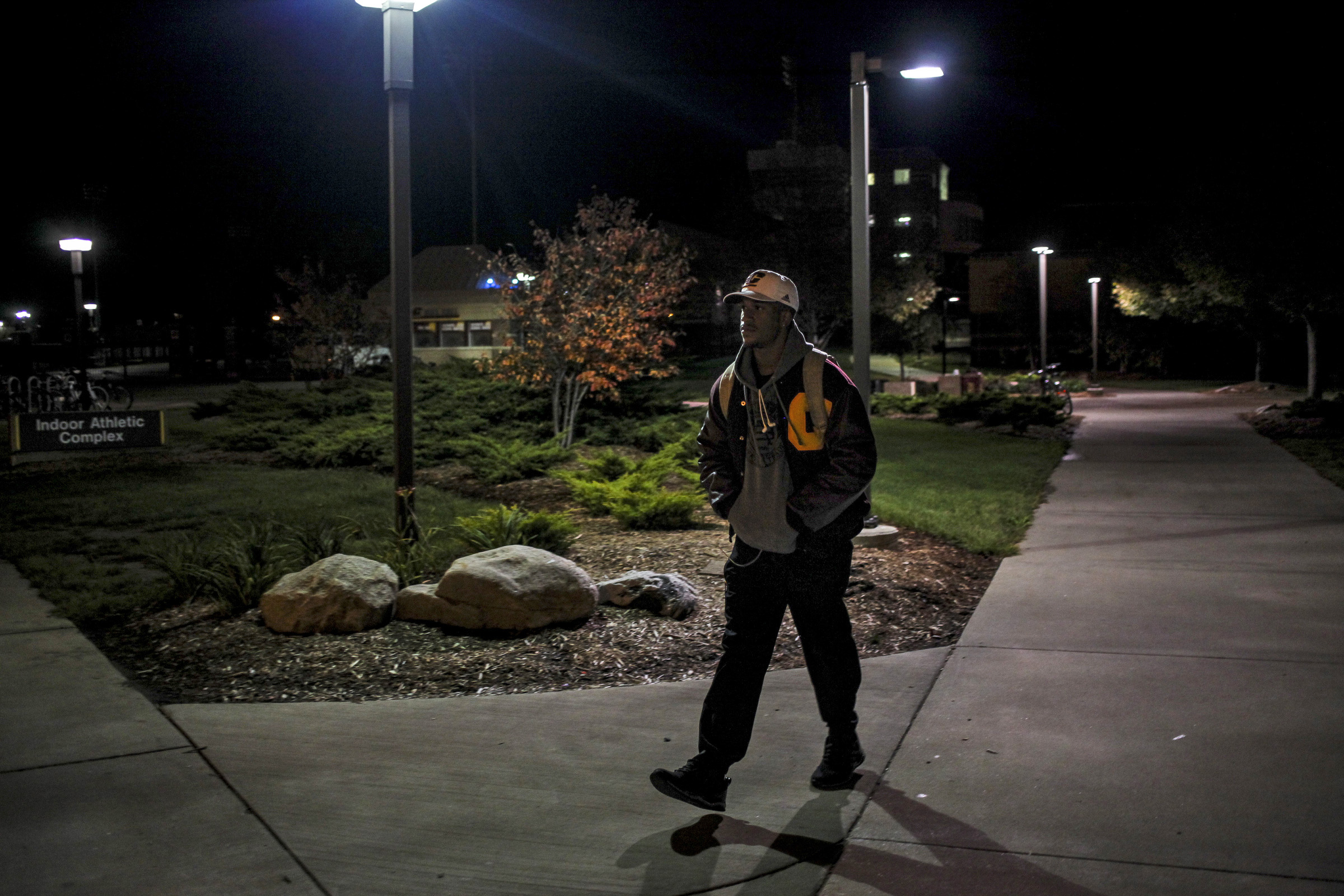 After a long day at school, Ray Golden, Jr., leaves campus. With days that start with early morning practices and a day full of classes, Ray gets to campus when it's dark and often doesn't leave until after dark. (Photo: Josephine Norris/GroundTruth)