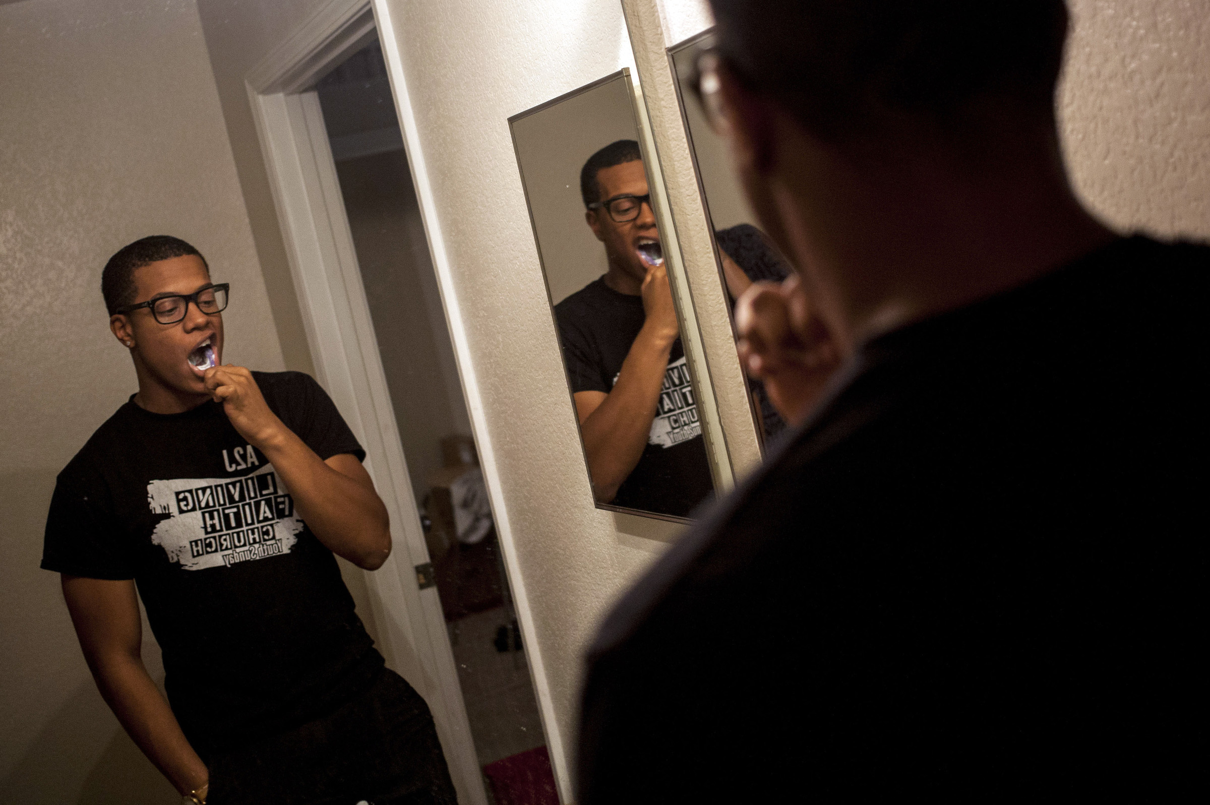 At the end of a long day, Trenton Carson brushes his teeth in his Mt. Pleasant apartment. (Photo: Josephine Norris/GroundTruth)