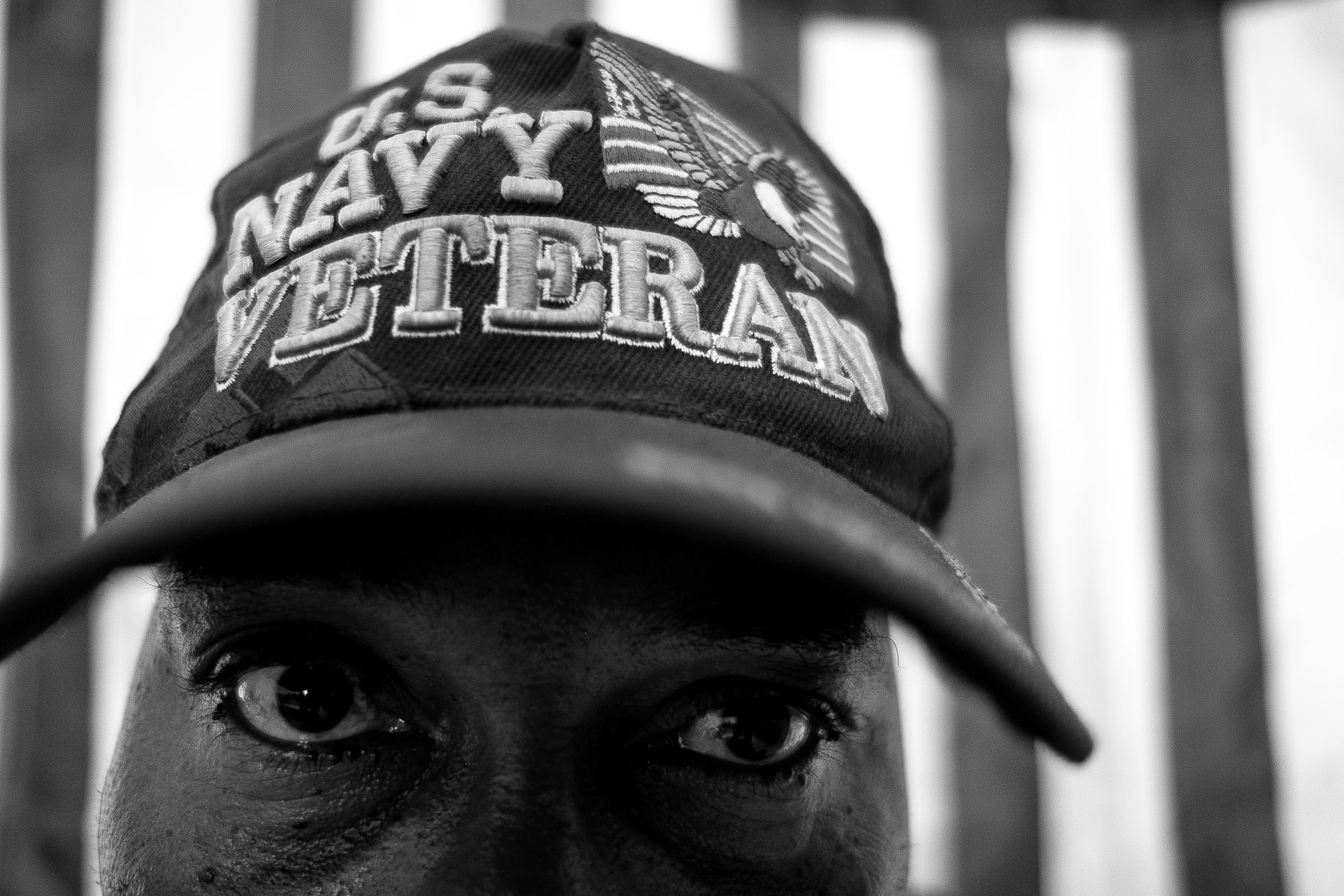 "Deported U.S. Navy veteran Steven B. Pierre, 51, poses for a portrait in a hotel room in Port-au-Prince, Haiti, Friday, June 29, 2018.   Pierre served in the U.S. Navy from 1990 to 1991 and received a medical discharge after falling down a submarine ladder stationed at a Naval dry dock in Connecticut. He tore up ligaments and tendons on his left knee and is currently service connected. He receives pain killers for his knee injury, and because of it, he also suffers from secondary injuries to his right knee and lower back.   ""I never thought that I was an immigrant,"" said Pierre. ""I always thought that I was an American because I was raised the American way.""   He has four children in the United States that grew up without him physically there for the majority of their lives. (Photo by Joel Angel Juárez/GroundTruth)"
