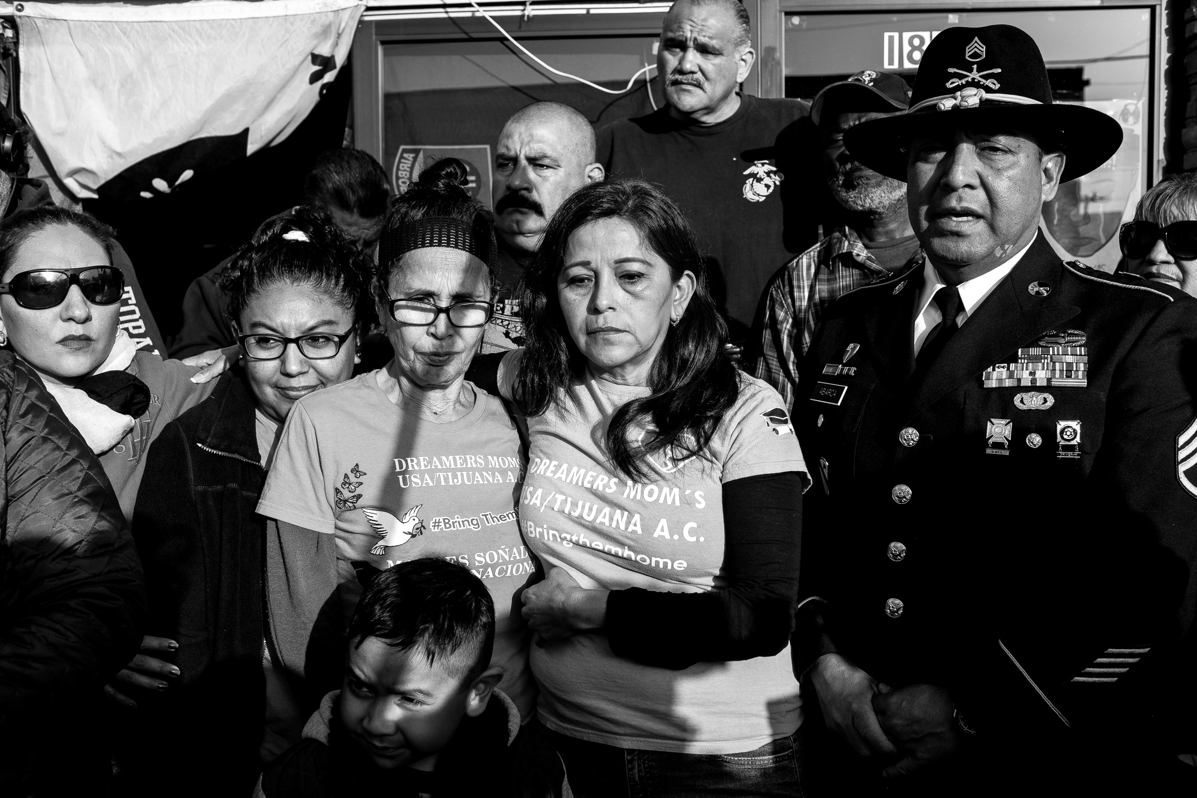 Supporters of deported U.S. Army veteran Hector Barajas-Varela—consisting of deported mothers and other U.S. military veterans—gather in Tijuana, Baja California, México, before he is sworn in as a U.S. citizen later that day in San Diego, Calif., Friday, April 13, 2018.   Barajas-Varela, not present in this photograph, spent a total of 14 years living in Mexico after two separate deportations in 2004 and 2010. (Photo by Joel Angel Juárez/GroundTruth)
