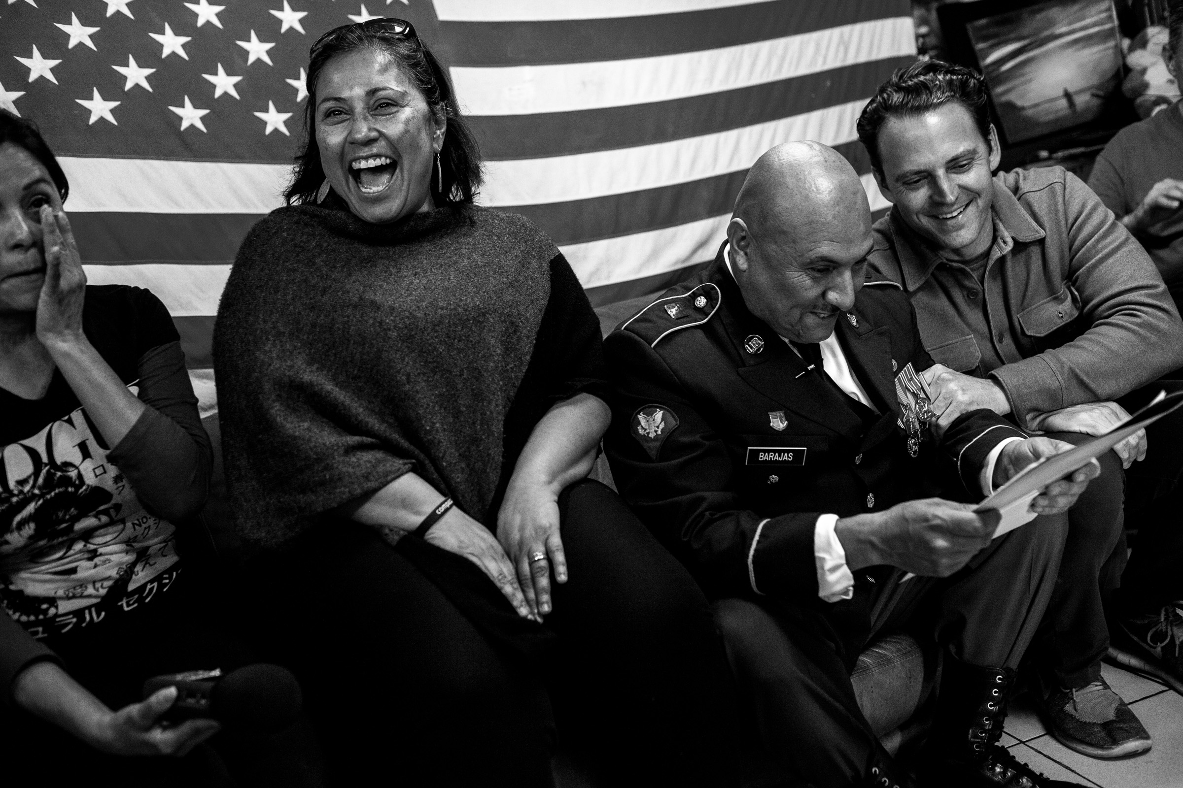 Deported mother Yolanda Varona, from left, Norma Chavez-Peterson, executive director of the ACLU of San Diego and Imperial counties, Hector Barajas-Varela, deported U.S. Army veteran Hector Barajas-Varela, and San Diego County Board of Supervisors candidate Nathan Fletcher, right, react after receiving a letter from immigration officials granting Barajas-Varela a naturalization ceremony in Tijuana, Mexico, Thursday, March 29, 2018.   Lawyers for Barajas-Varela said the government informed them Thursday their client should attend a naturalization ceremony on April 13 in San Diego. U.S. Citizenship and Immigration Services confirmed the decision. (Photo by Joel Angel Juárez/GroundTruth)