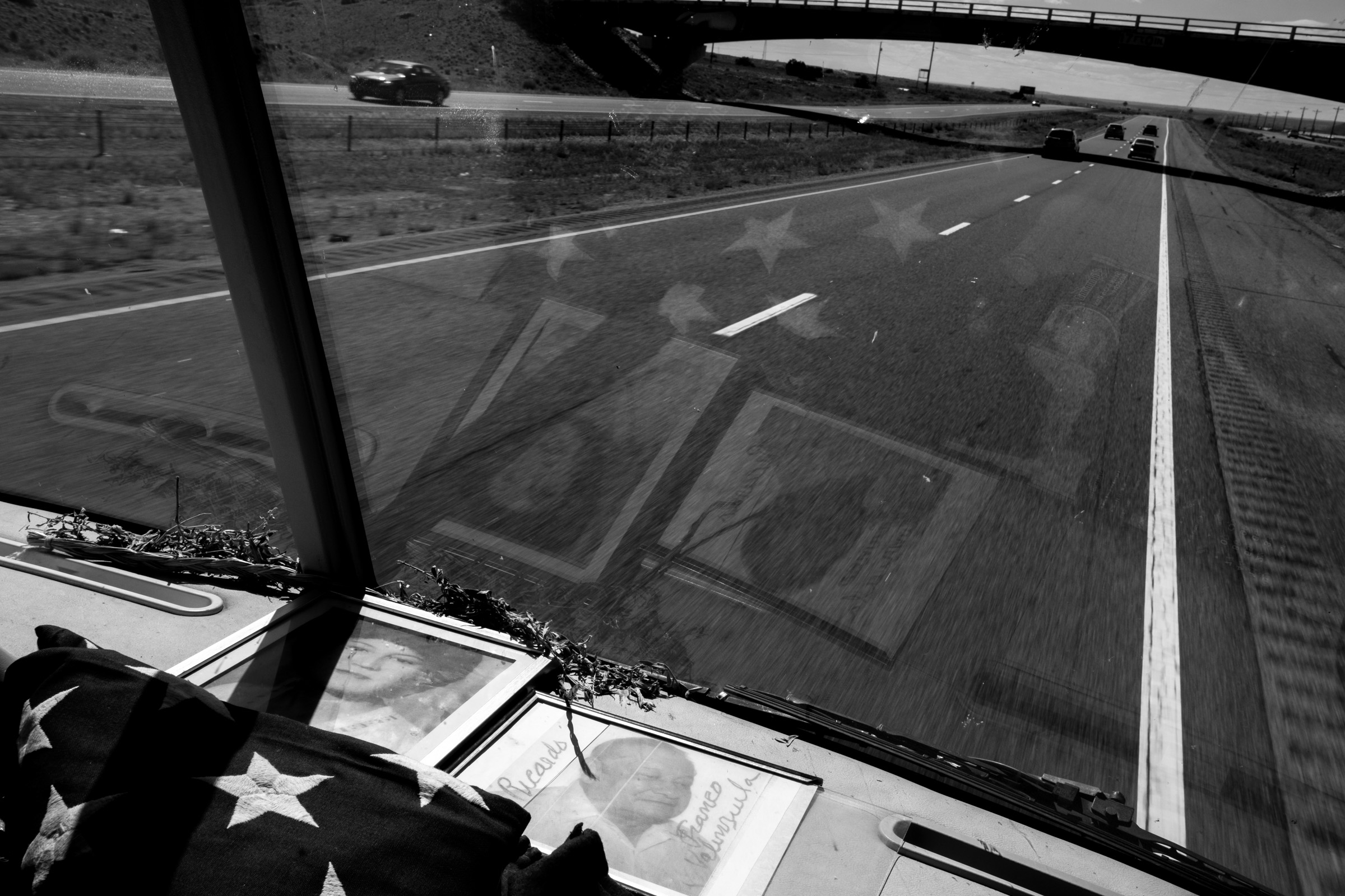 A framed photograph of the parents of U.S. Vietnam War veterans Manuel Valenzuela, 66, and Valente Valenzuela, 70, lays on the dashboard of their RV during a trip across America raising awareness for deported U.S. military veterans.   The Valenzuela brothers have been fighting deportation since 2009 for misdemeanor offenses which they completed sentences for. Their birth certificates classify them as resident aliens since their mother, a native from New Mexico, gave birth to them in México. Their deportation cases have been lingering in the courts. They might qualify as U.S. citizens as a result of their mother's citizenship status. (Photo by Joel Angel Juárez/GroundTruth)