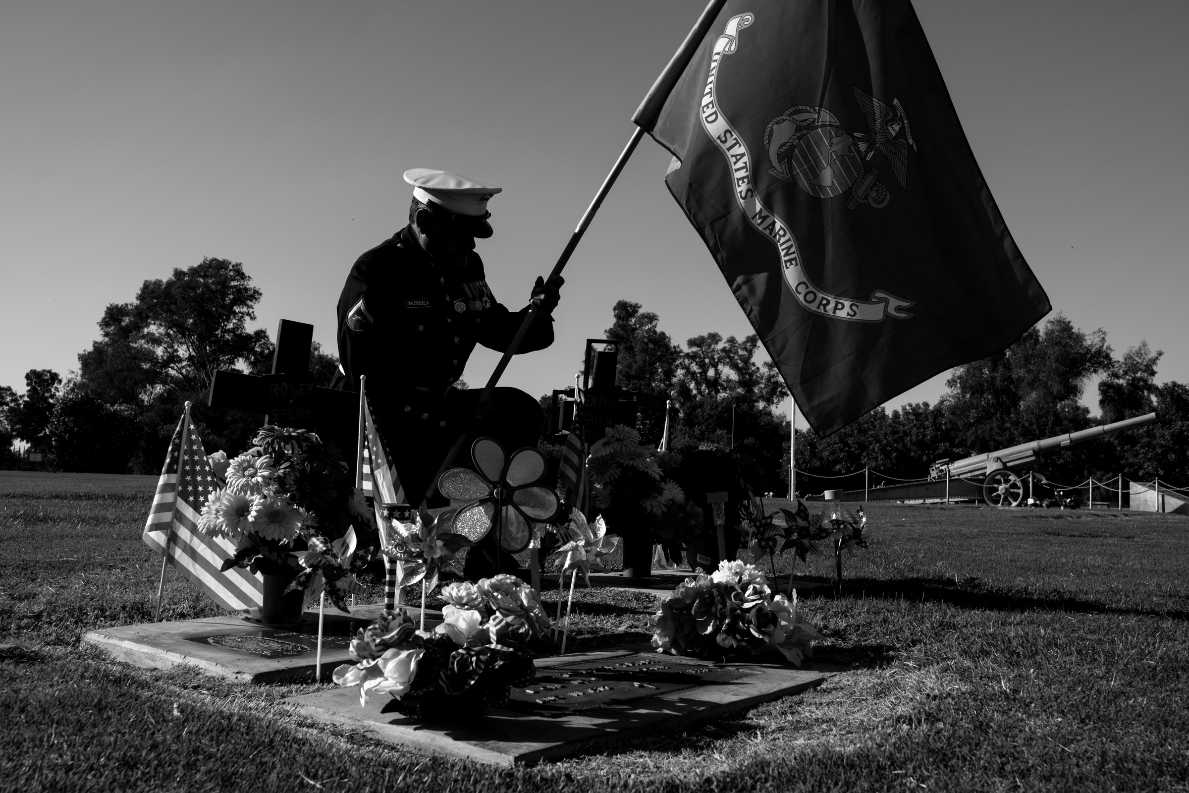 U.S. Marine Corps and Vietnam War veteran Manuel Valenzuela visits the burial site of deported U.S. Marine Corps veteran Enrique Salas, right, in Reedley, California, Monday, October 8, 2018. Valenzuela and his older brother Valente, a U.S. Army and Vietnam War veteran, have been fighting deportation since 2009.   Salas, who was deported and living in Tijuana, died en route to a hospital in the United States after being seriously injured in a car accident in Tijuana. It took 10 days for an emergency humanitarian parole visa to be granted allowing Salas to receive better care in the United States. Salas, deported in 2006, was able to return to the U.S. only to be buried with military honors next to his younger brother, another fallen Marine. (Photo by Joel Angel Juárez/GroundTruth)
