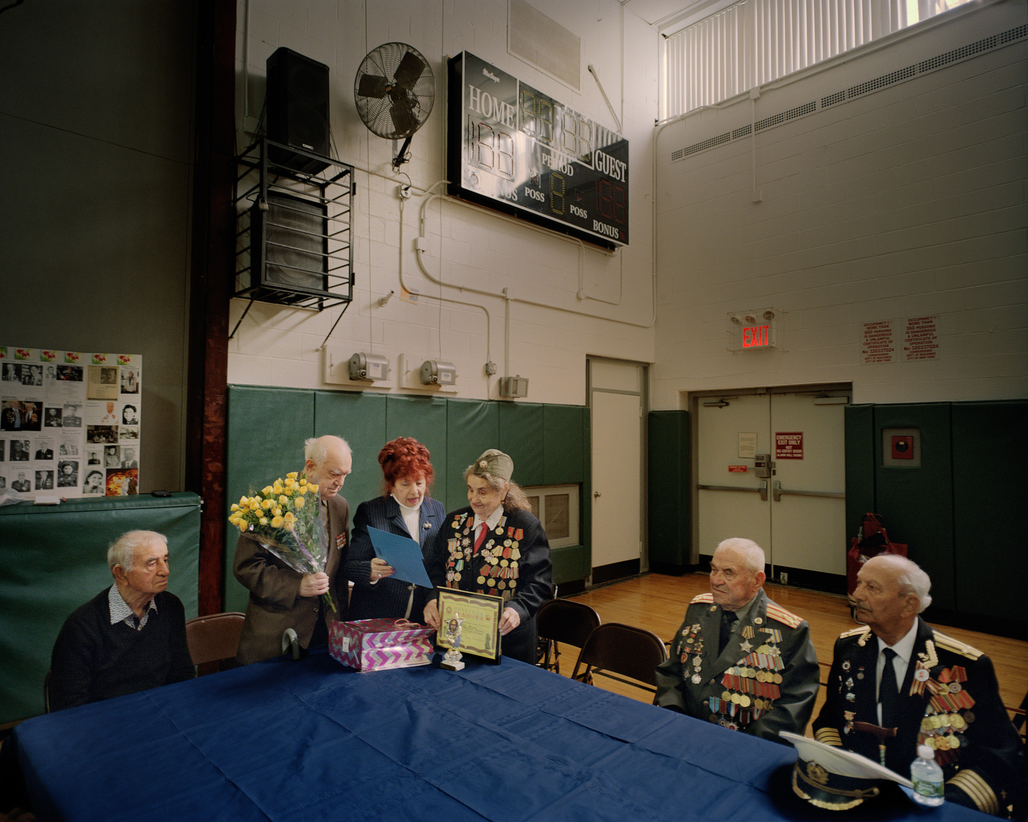 "American Association of Veterans and Invalids, honoring a Veteran and Holocaust survivor Anastasia Guildina (Center), on her 93rd birthday at the Sorefront ""Y"" during the meeting with the local youth. (Photo by Alexey Yurenev/GroundTruth)"