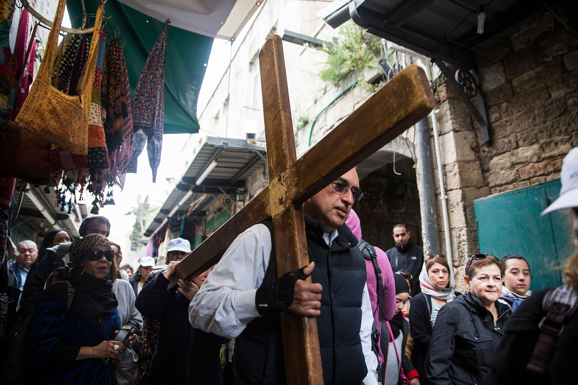 Christian worshippers along the Via Dolorosa during the Good Friday procession in Jerusalem's Old City.Christians held processions today in the Old City of Jerusalem and around the world as they marked the holiday of Good Friday,commemorating the crucifixion of Jesus Christ and his death at Calvary .(Photo by Heidi Levine for The GroundTruth Project)