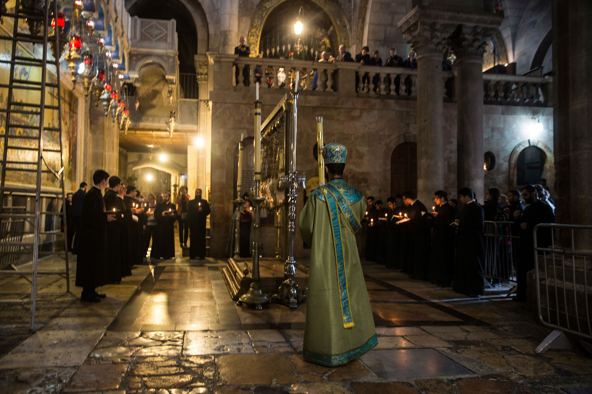 Armenian Orthodox Priests chanting at the Stone of Anointing, which is also called the Stone of Unction inside the Church of the Holy Sepulchre in the Old City of Jerusalem on March 30,2018.This stone marks the place where Jesus' body was prepared for burial after He was taken down from the cross. Christians around the world today marked Good Friday,commemorating the crucifixion of Jesus Christ and his death at Calvary. (Photo by Heidi Levine for The GroundTruth Project)