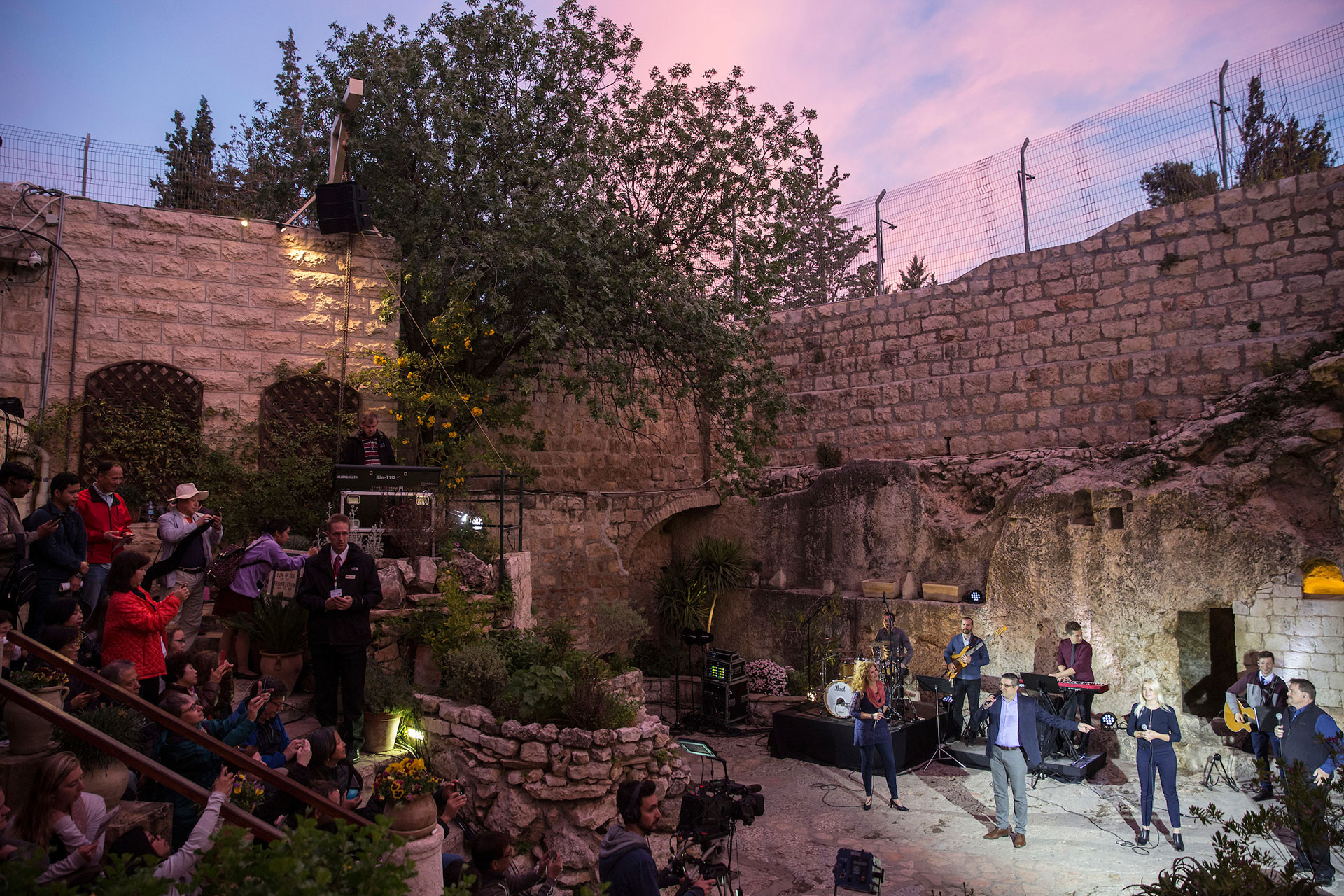 The ceremony at the Garden Tomb  is accompanied by music. (Photo by Heidi Levine for The GroundTruth Project).