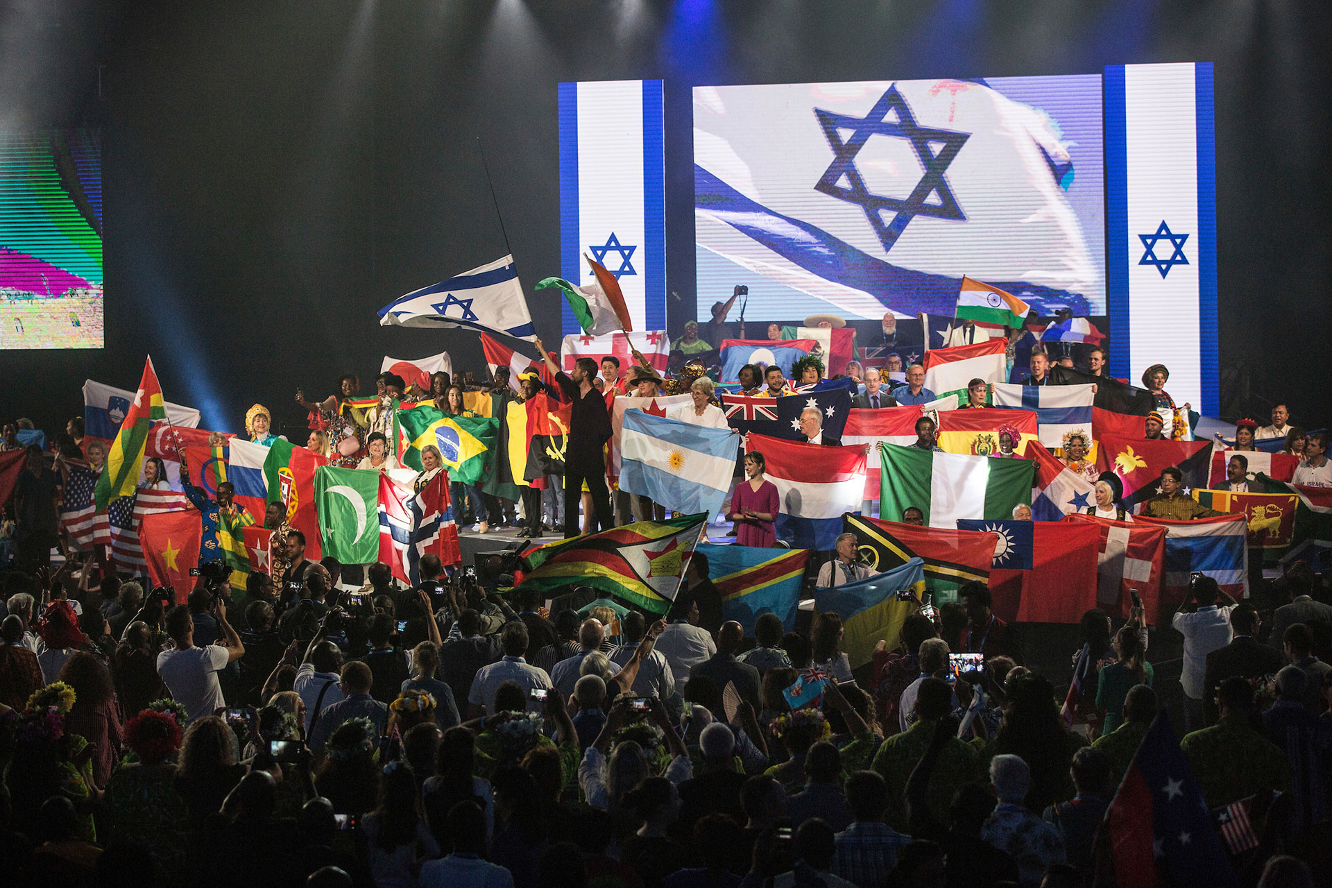 Thousands of Evangelical Christian pilgrims from around waving their national flags gathered for the Parade of Nations and opening ceremonies for the 2018 Feast of Tabernacles on September 24,2018 at the Pais Arena in Jerusalem. The Feast of Tabernacles is the Christian term for the weeklong Jewish holiday of Sukkot. In biblical times the holiday was marked by a pilgrimage to the Temple in Jerusalem. Numerous events are planned in Jerusalem , including a march and other celebrations for the week long holiday . (Photo by Heidi Levine for The GroundTruth Project).