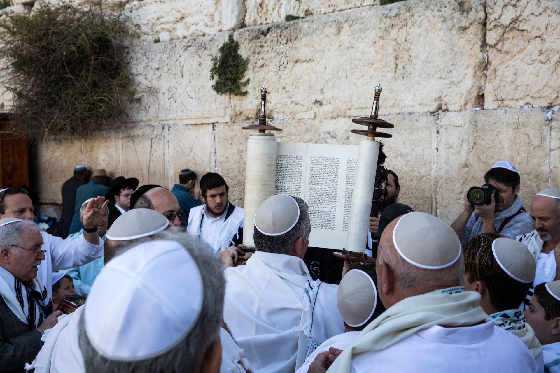 A Torah scroll is seen during a Bar mitzvah of a 12 year old boy as Ultra-Orthodox Jewish men of the Cohanim Priestly caste, many covered in their prayer shawls during a blessing during the Jewish holiday of Passover at the Western Wall, the holiest site where Jews can pray in Jerusalem's old city, on Monday, April 2, 2018. The Cohanim, are believed to be descendants of priests who served God in the Jewish Temple before it was destroyed. The blessing ceremony of the Cohanim is performed three times a year during the festivals of Passover, Shavuot and Sukkot.(Photo by Heidi Levine for The GroundTruth Project).