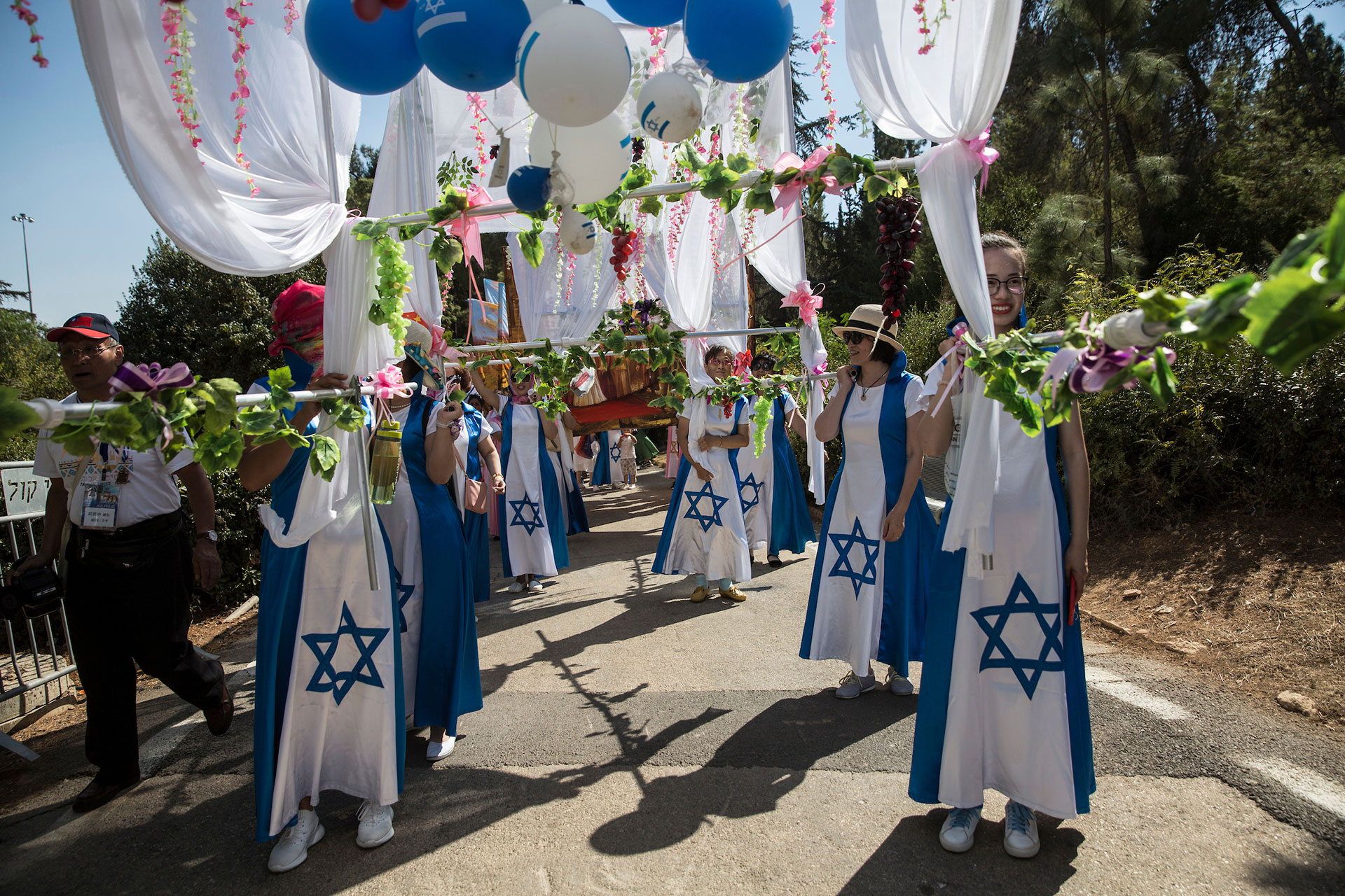 Christian pilgrims from China participate during a parade in Jerusalem on September 27,2018. Thousands of Christians from around the world came to Jerusalem for the week long Feast of Tabernacles, also known as Sukkot. (Photo by Heidi Levine for The GroundTruth Project).