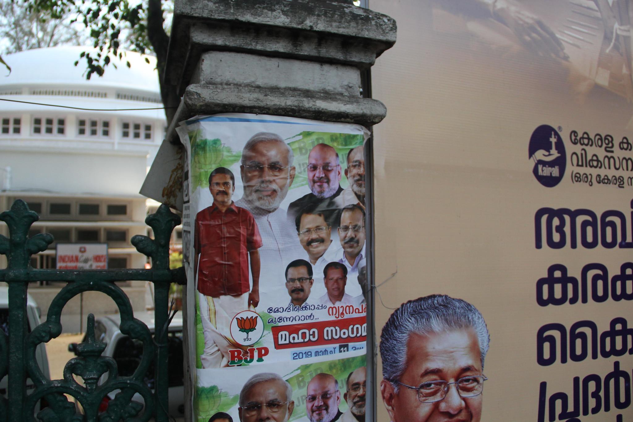 A BJP political poster in Thiruvananthapuram. (Photo by: Diana Kruzman)