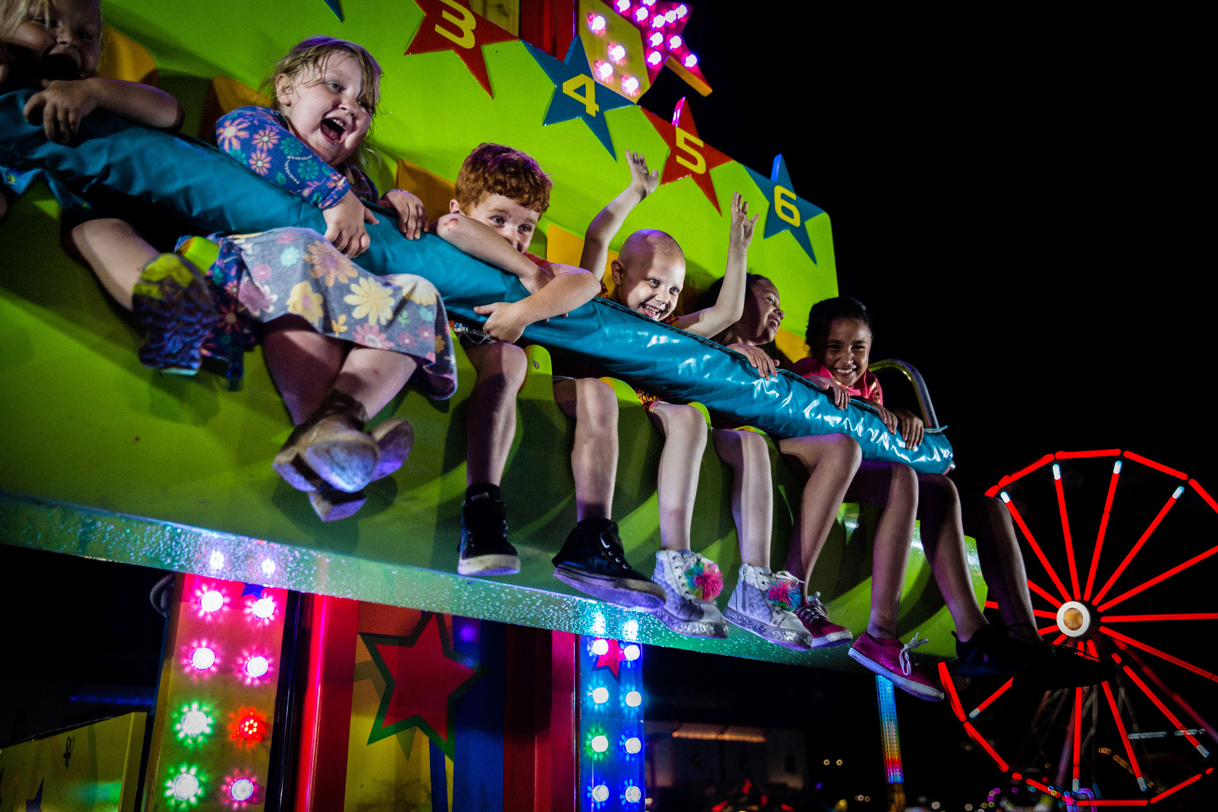 "Kaylee, age six, and her sisters fall from the Great New York State Fair's ""drop tower"" on the last day of the 2018 fair.