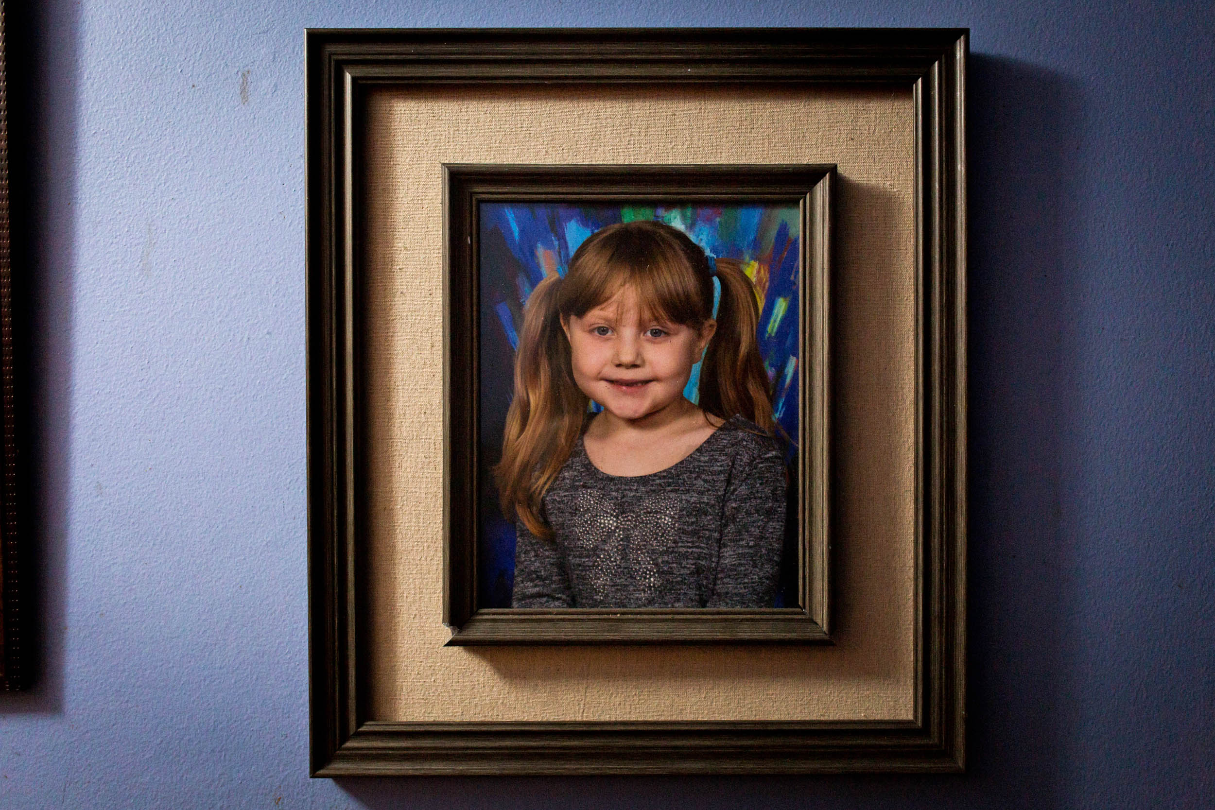 A picture of Kaylee Marshfield, 5, taken only months before being diagnosed with cancer, hangs in the hallway of the Marshfield home. (Photo by Maranie Staab/GroundTruth)