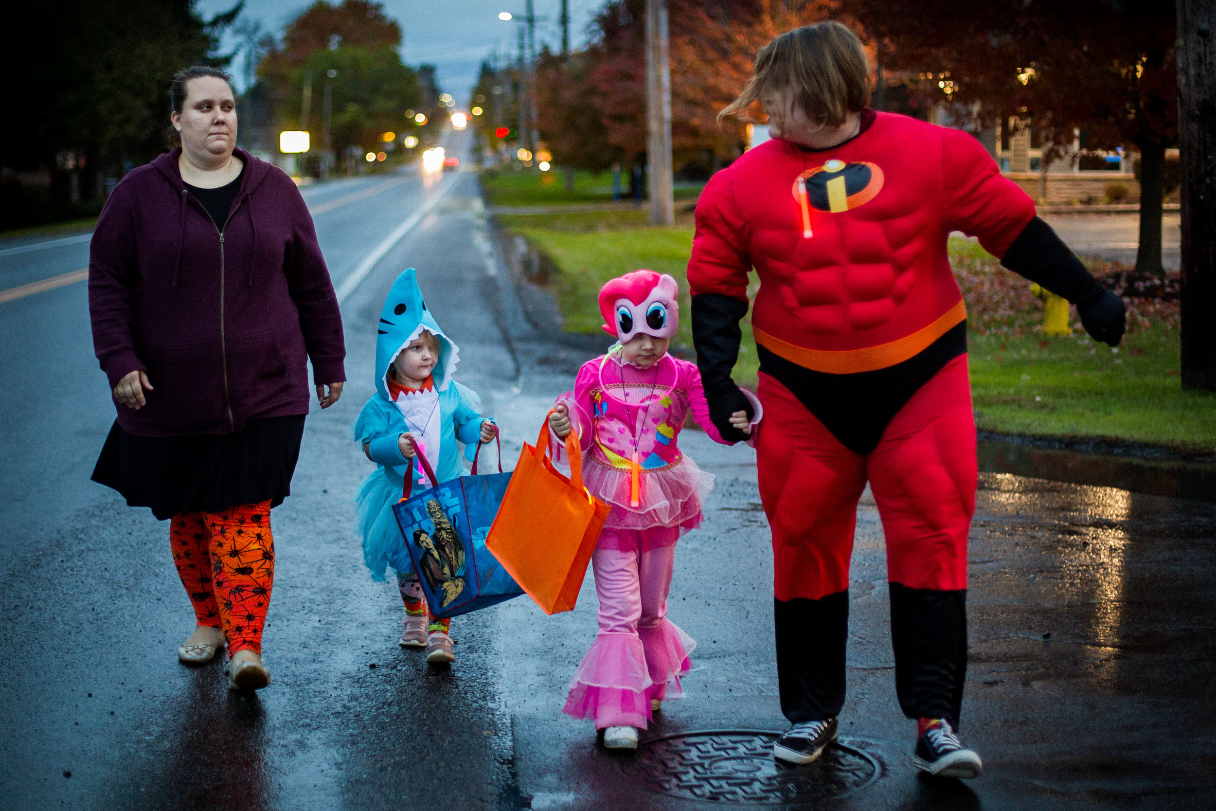 "Kristina and her son from her first marriage, Dylan, age 16, exchange a glance while walking with Isabelle and Kaylee on Halloween night. This year Kaylee chose to dress up as the character ""Pinkie Pie."" (Photo by Maranie Staab/GroundTruth)"