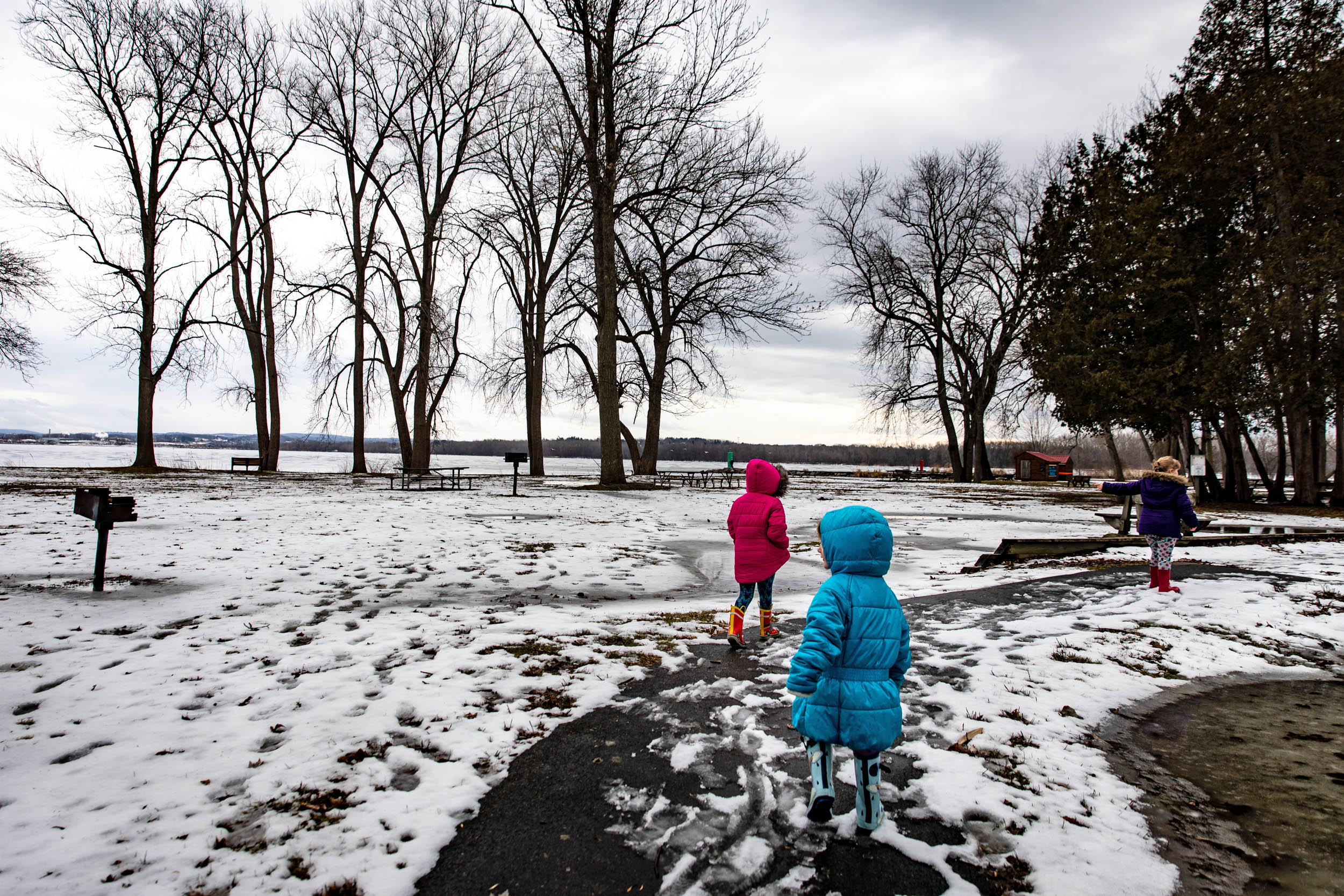 Kaylee and her sisters braved the waning winter cold to spend park of their Sunday outside at the Onondoga Lake State Park. (Photo by Maranie Staab/GroundTruth)