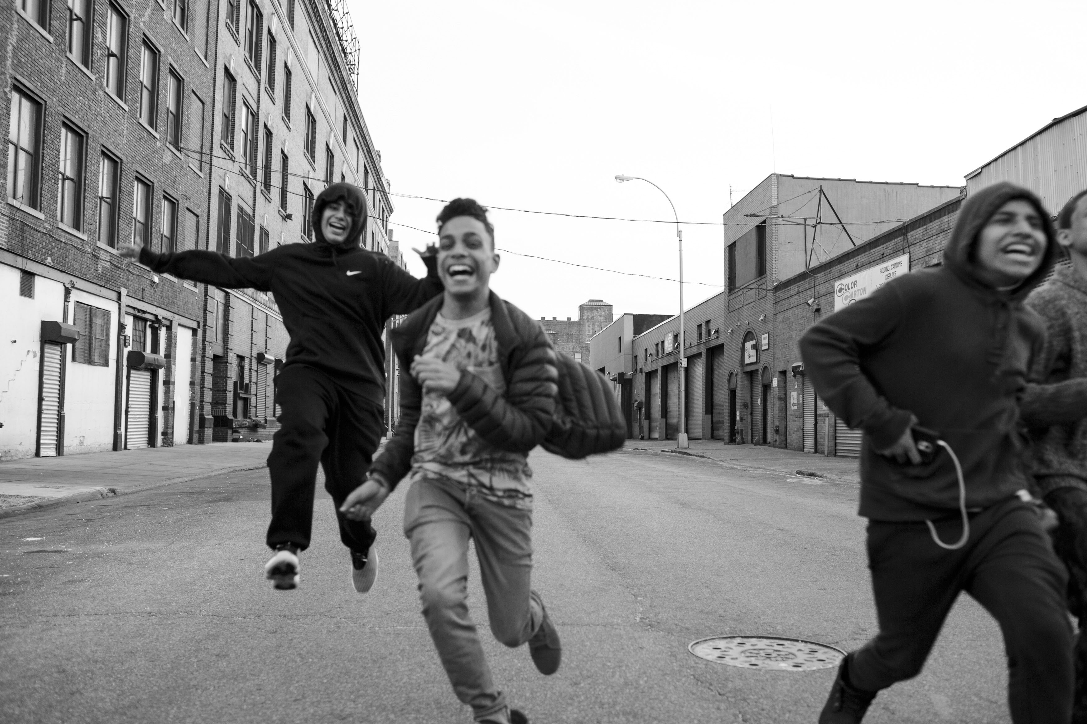 Juan Neira, Chavi Leon, Marco Vasquez and Edwin Amaro running on an afternoon free of school, 10 Apr 2016, Mott Haven, Bronx. All four boys attend different schools, but live on the same block. (Photo by Sarah Blesener/GroundTruth)