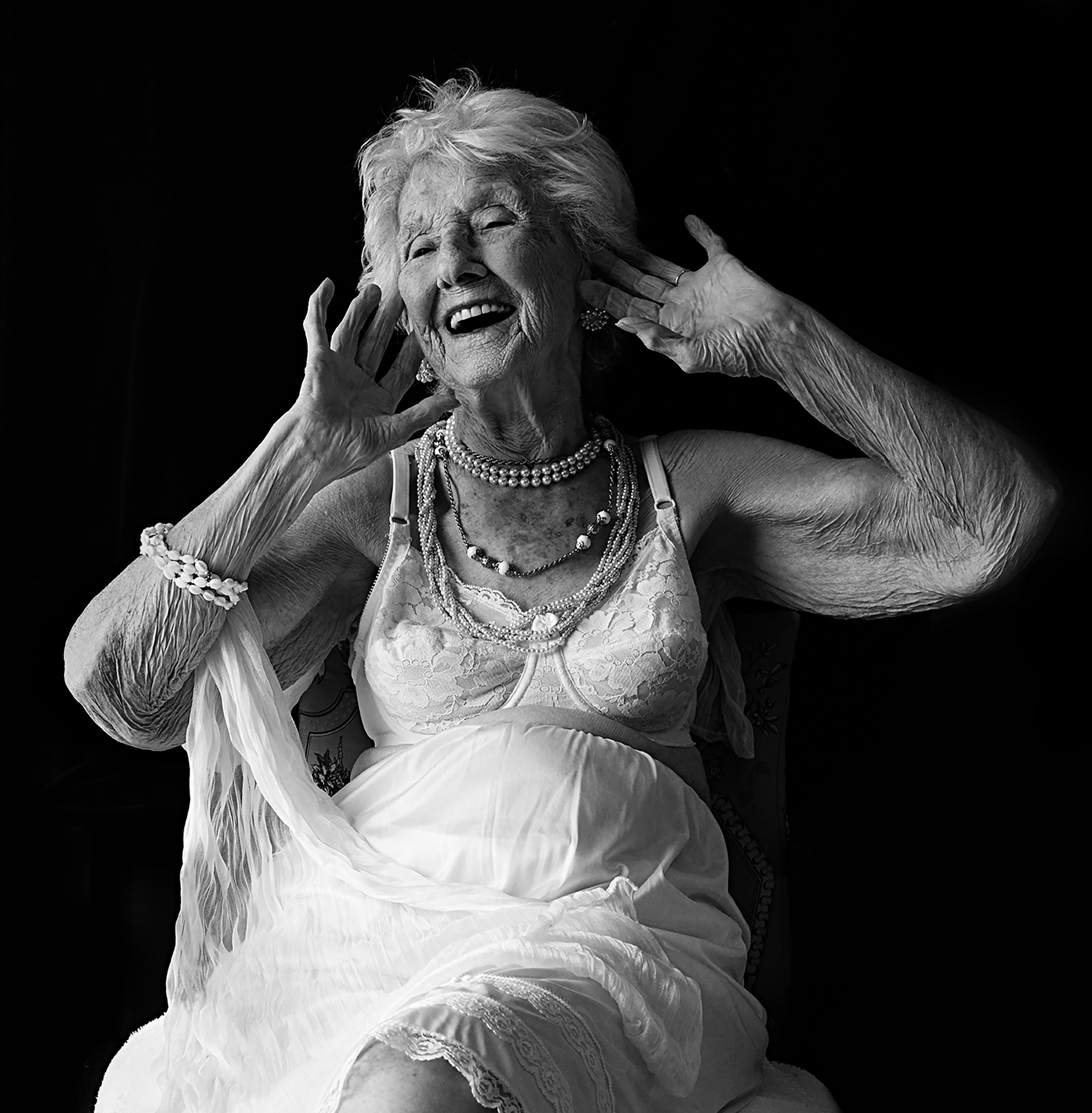 """105-year-old Marie-Berthe Paquette of Montreal offers this advice on aging: """"I personally find myself beautiful, and when I don't, I do my best anyways! I like to have my hair neatly styled and wear dresses, jewelry and other accessories. I've always paid attention to my appearance. In fact, I'm known as 'la fraîche' (the trendy lady)"""". (Arianne Clément/GroundTruth)"""
