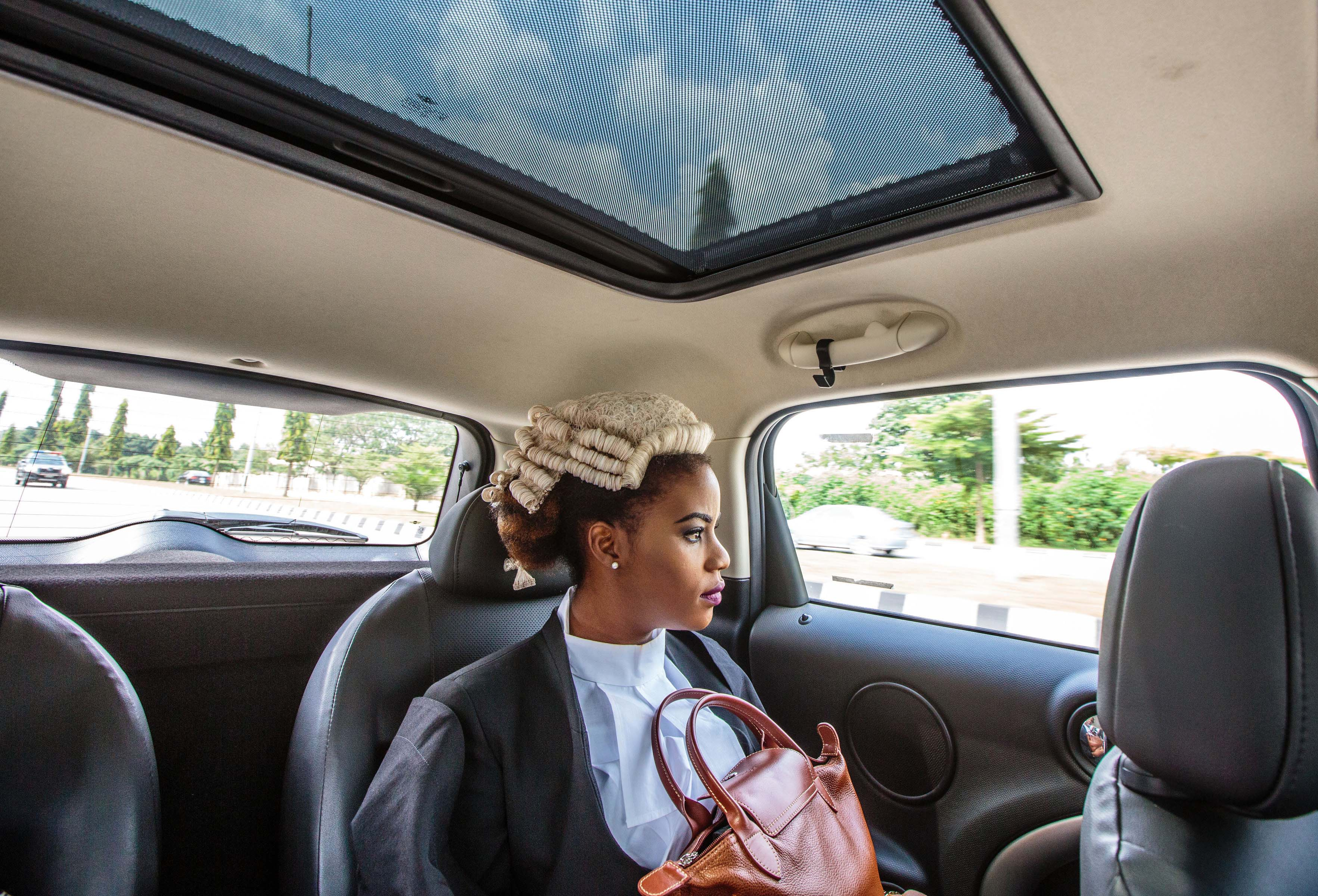 October 2015: Thousands of Nigerian law graduates were called to the bar in Abuja. Ginika, one of the young lawyers to be, on her way to the big ceremony. (Photo by Tom Saater/GroundTruth)