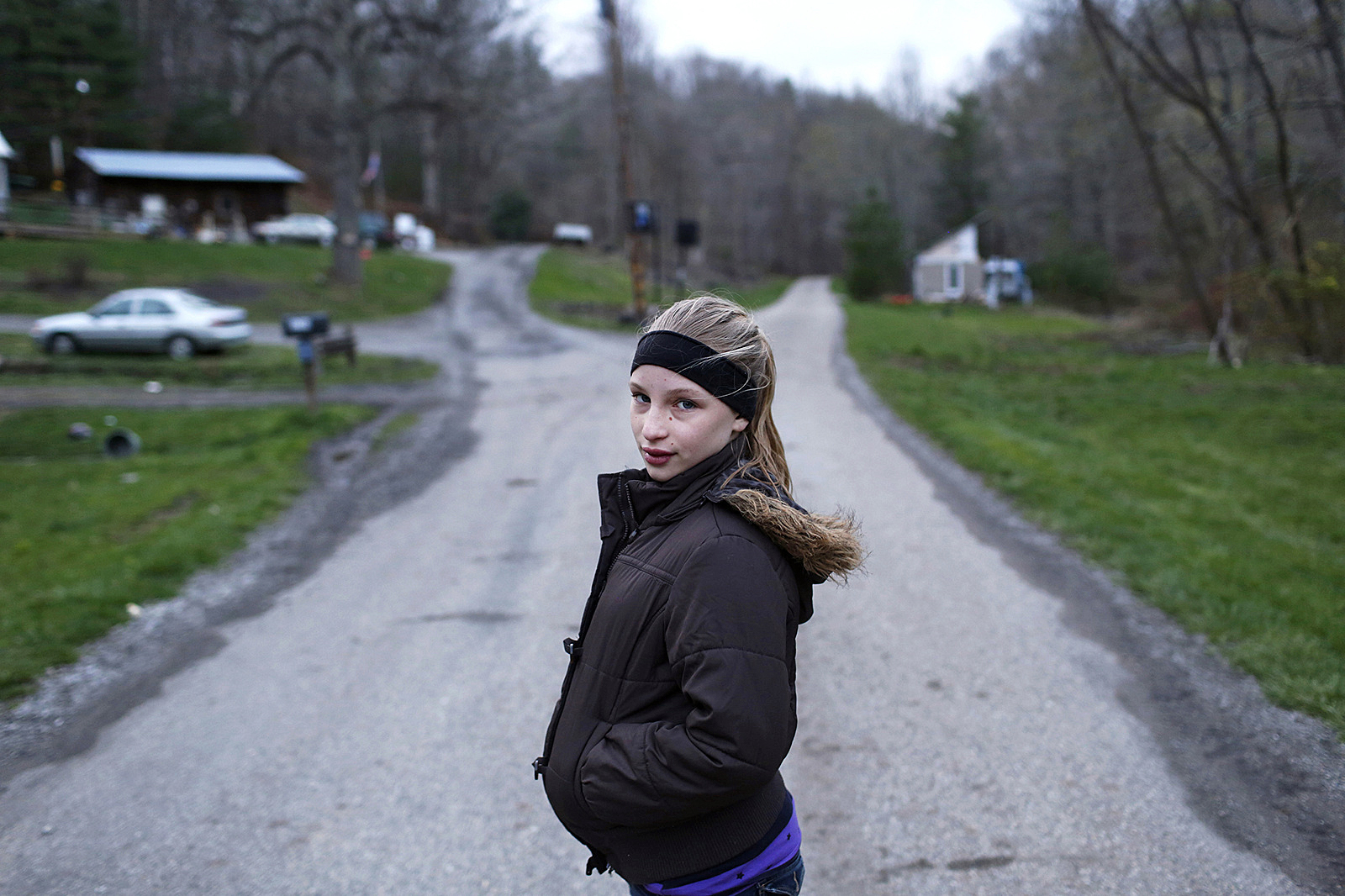 Sonya, now 13, stood on her street in Carbondale, which was a coal mining town in in Southeastern Ohio. The mines have all been closed years ago.  (Photo by Maranie Staab/GroundTruth)